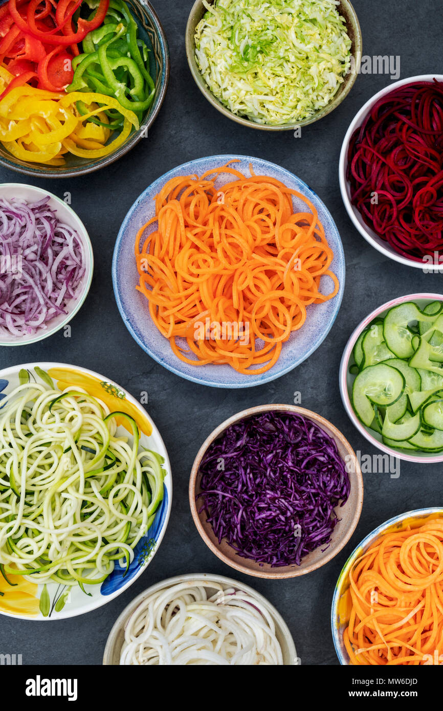 Spiralized Vegetables in bowls on a slate background. Pattern Stock Photo