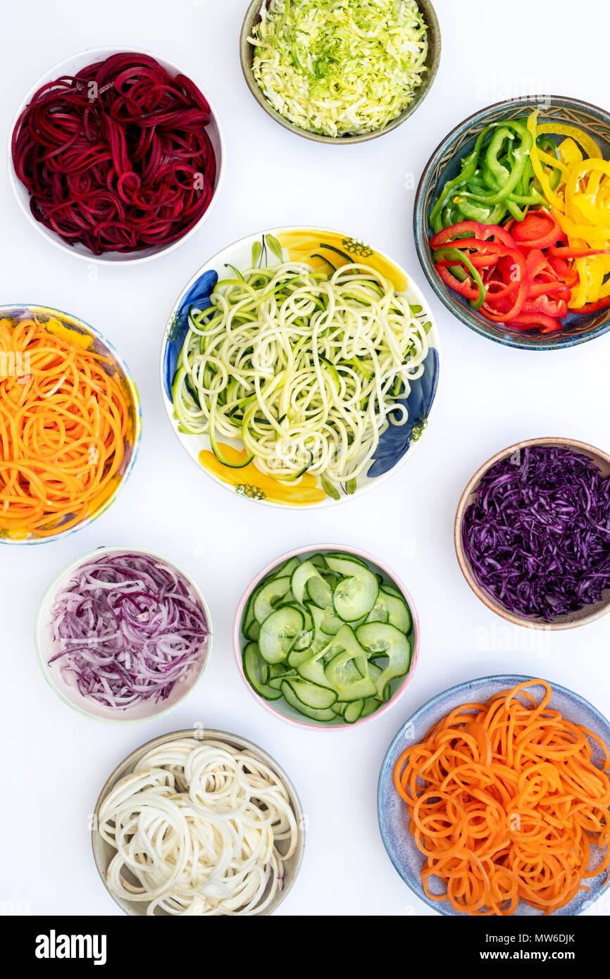 Spiralized Vegetables in bowls on a white background. Pattern Stock Photo