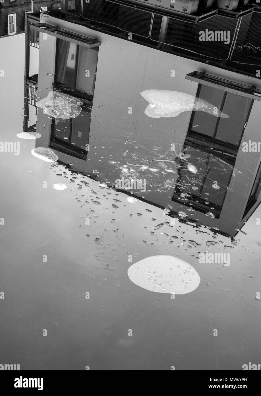 EDINBURGH, SCOTLAND- JANUARY 7TH 2009: A black and white photograph of a reflection of a house in the Union Canal water in Edinburgh. - Stock Image