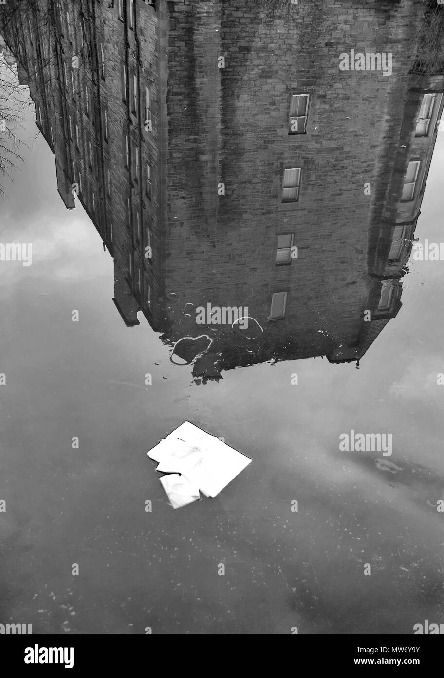 EDINBURGH, SCOTLAND- JANUARY 7TH 2009: A black and white photograph of a reflection of a tenement block in the canal water. - Stock Image
