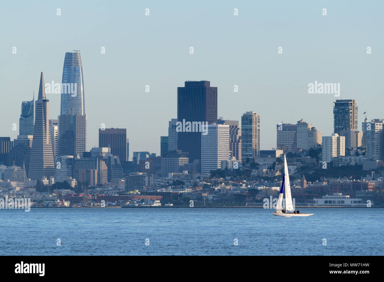 San Francisco skyline as seen from the water with sailboat. - Stock Image