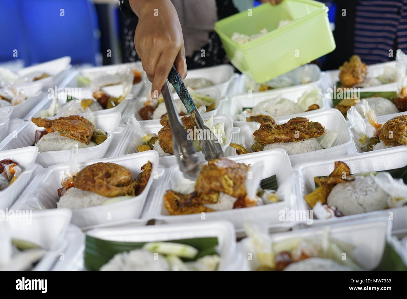 Vendor selling Crispy Fried chicken during fasting month at Street market food in Banda Aceh, Indonesia - Stock Image