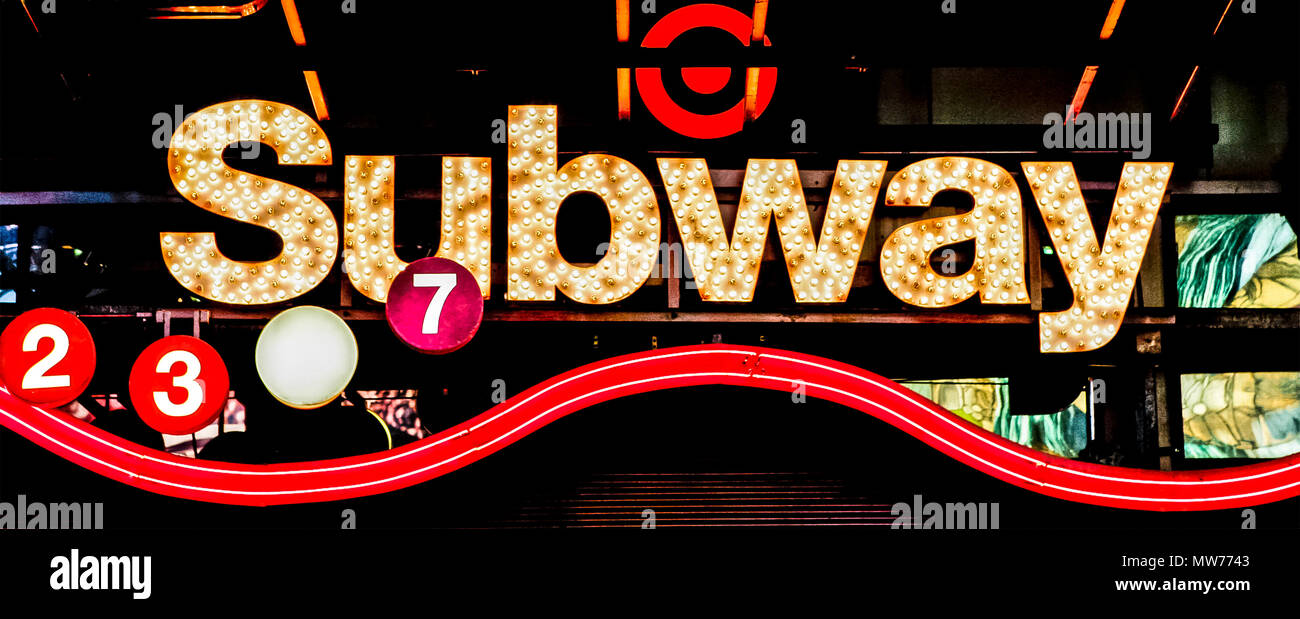 New York subway, Times Square station neon sign lights at night. Close up. Transport. Manhattan. New York City, NY, United States of America, USA - Stock Image