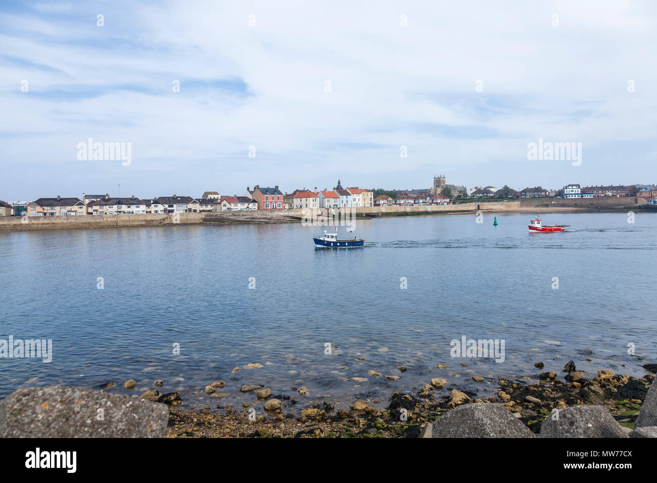 Two boats enter the harbour area at the Headland at Old Hartlepool,England,UK - Stock Image