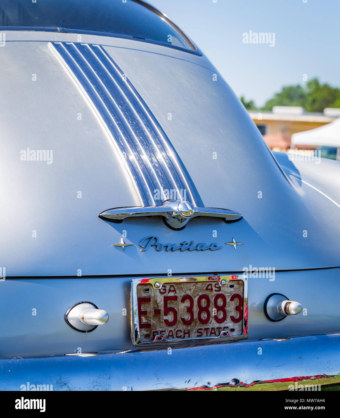 Rearview of the trunk and rear bumper of a 1949 Pontiac Chieftan 2 door Coupe at a classic car show - Stock Image