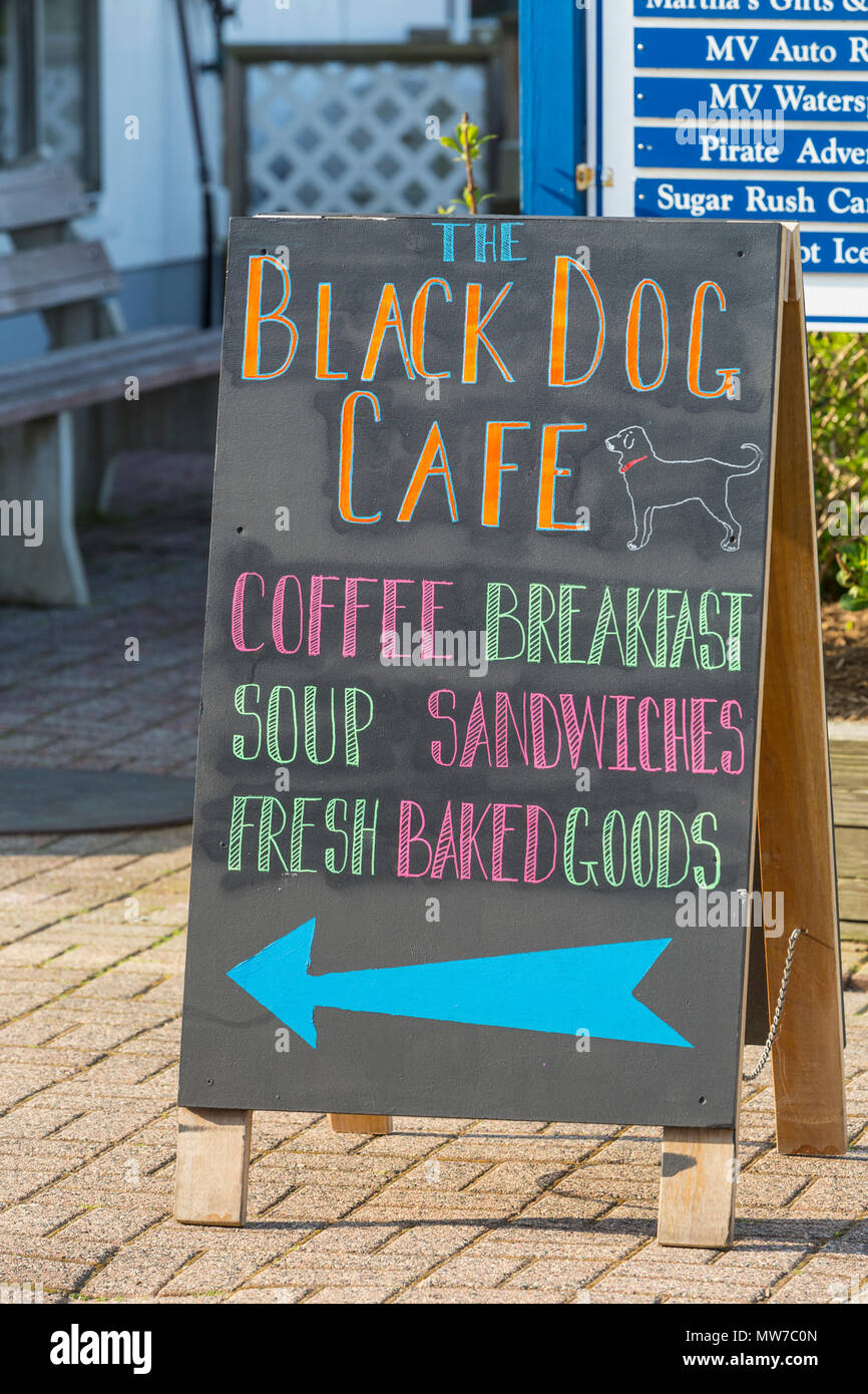 A sign points customers to the Black Dog Cafe in the Dockside Waterfront Marketplace on Oak Bluffs marina on Martha's Vineyard. - Stock Image