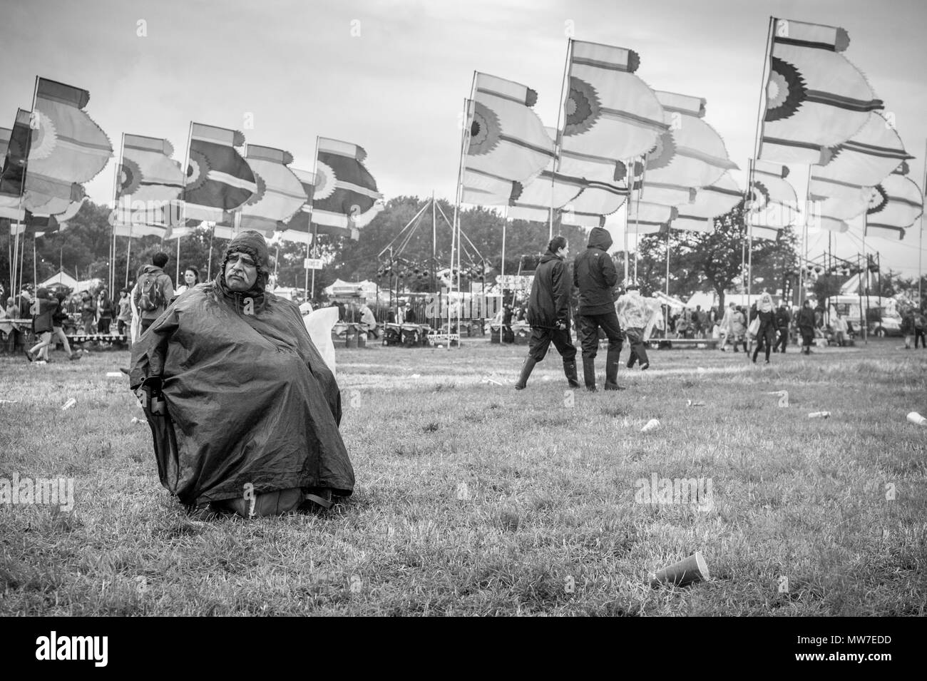 A festival goer watches a band at the Glastonbury Festival 2015 - Stock Image
