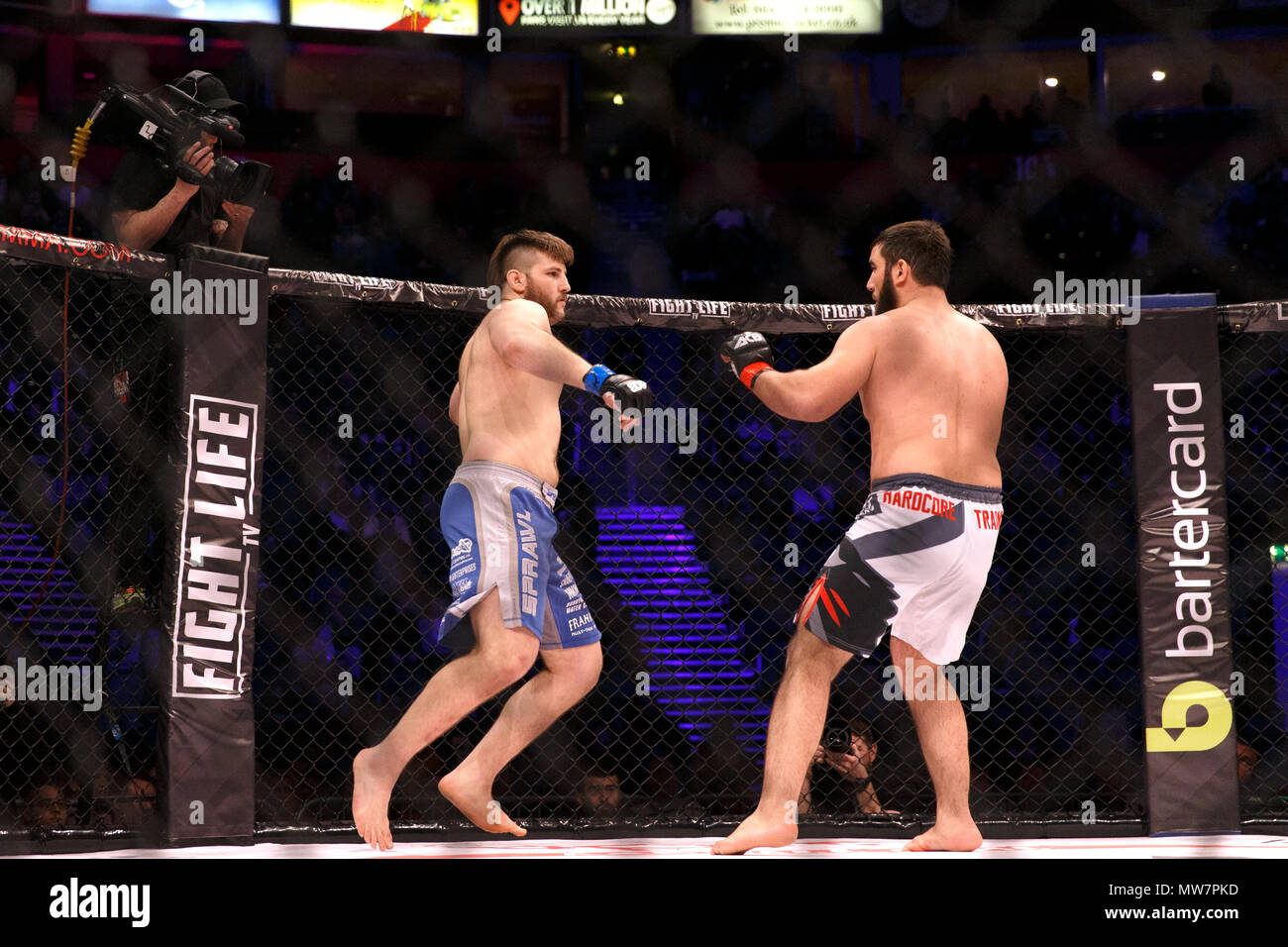 Tanner Boser (left) motions to launch a punch at Mukhomad Vakhaev (right) at ACB 54 in Manchester, UK. Vakhaev won via a split decision and went on to win the ACB Heavyweight Championship in his next fight. Absolute Championship Berkut, Mixed Martial Arts, MMA fight. - Stock Image