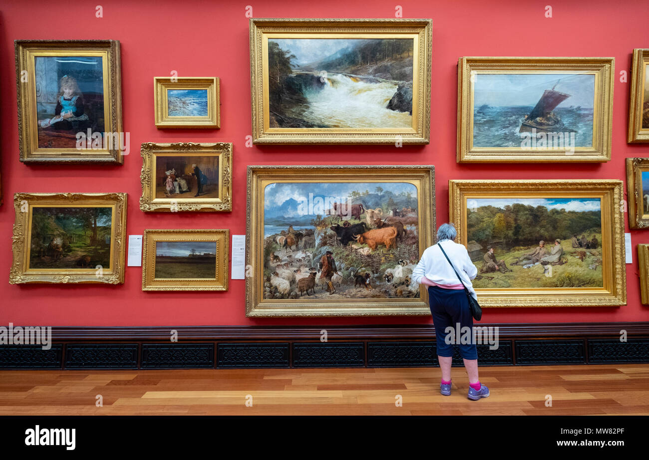 Woman looking at paintings in the Victoria Gallery  inside the McManus art gallery and museum in Dundee, Tayside, Scotland, UK - Stock Image
