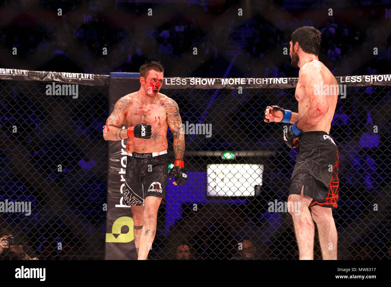 A bloodied Adam Zając (left) fights Abdul-Rakhman Dzhanaev during the second round of their middleweight encounter at ACB 54 in Manchester, UK. Zając would eventually lose due to a doctor's stoppage. Absolute Championship Berkut, Mixed Martial Arts, MMA fight. - Stock Image