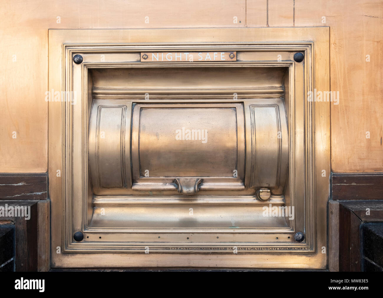 View of old brass night safe outside bank - Stock Image