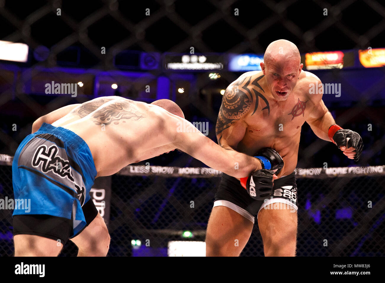Mixed Martial Arts (MMA) fighter Shaun Hampton catches Gaz Corran in the chest with a right hook at ACB 54 in Manchester, UK. Corran would ultimately win the fight by unanimous decision. Absolute Championship Berkut, Mixed Martial Arts, MMA fight. Stock Photo