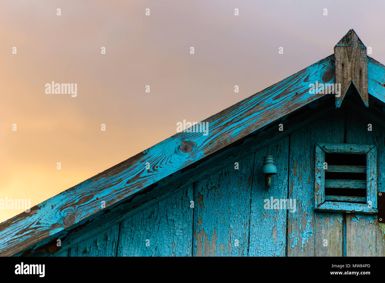 old roof with shabby blue paint - Stock Image