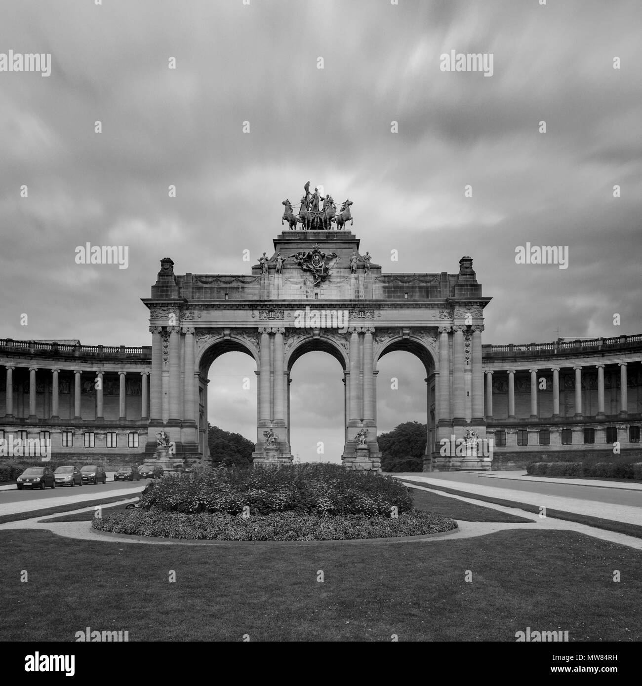 Long exposure B&W image of the The Triumphal Arch in Cinquantenaire Parc in Brussels - Stock Image