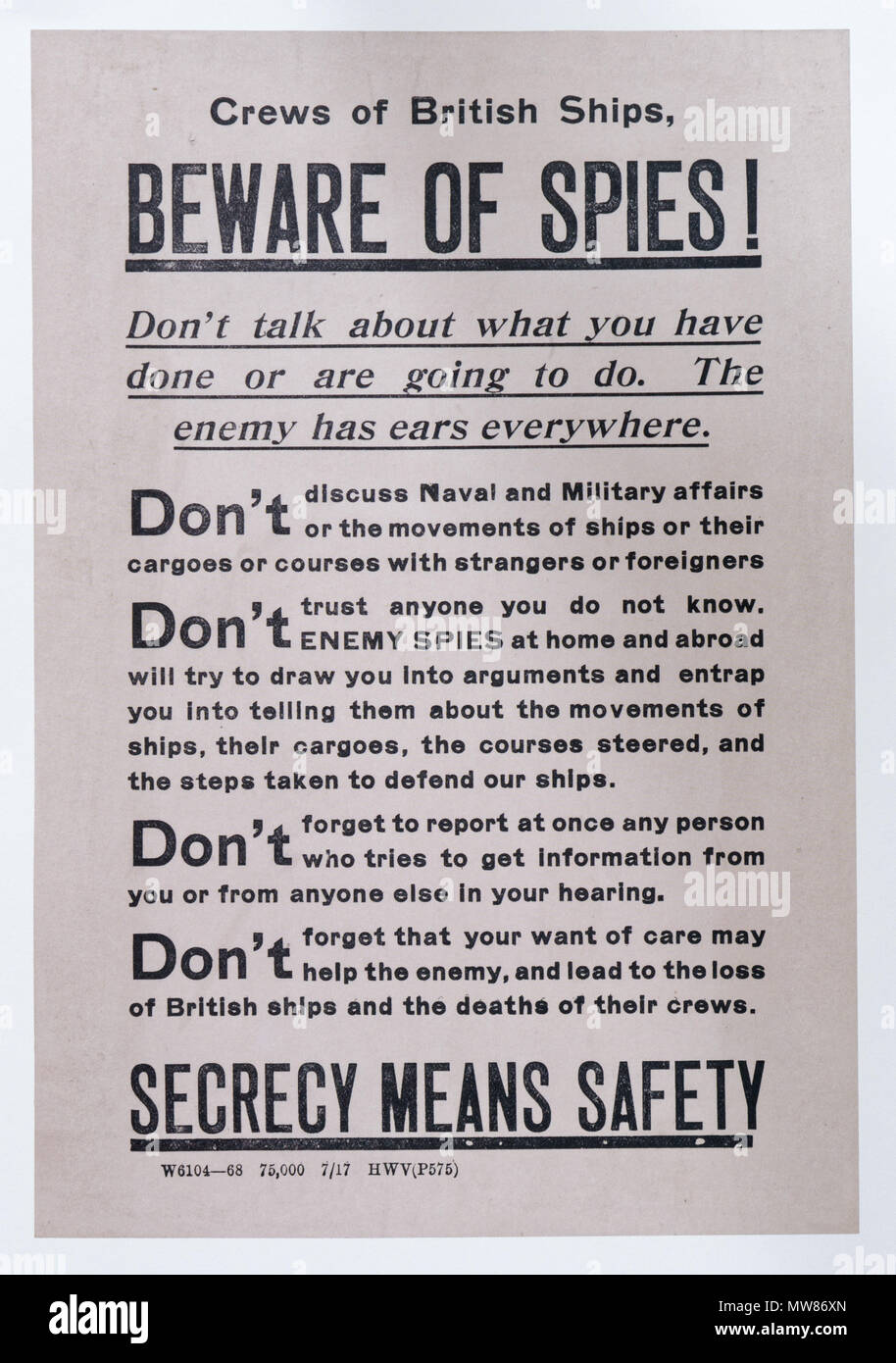 A British first world war poster cautioning crews of ships to beware of spies - Stock Image