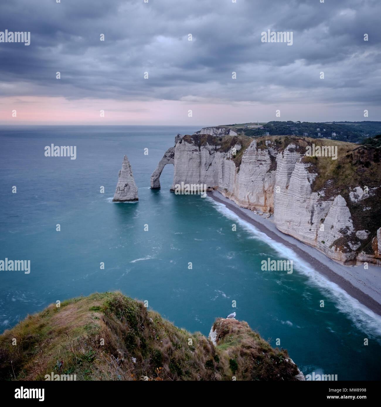 Cliffs of Étretat at sunset. Normandy, France. - Stock Image