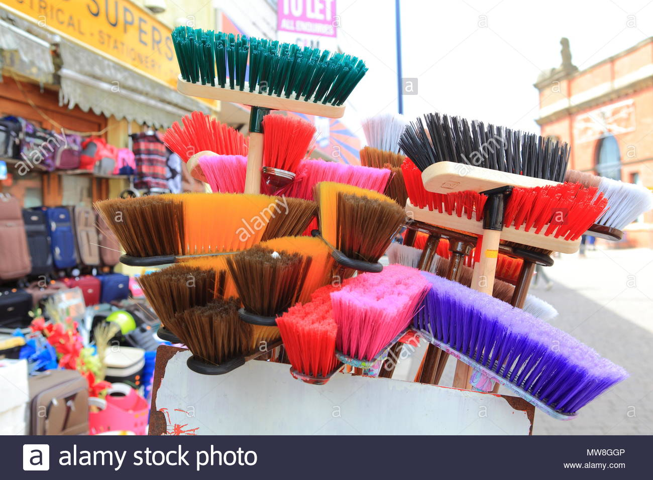 Household Cleaning Utensils & Brushes Displayed Outside A Pound Busters Store At Ashton-Under-Lyne Tameside England June 2018 - Stock Image