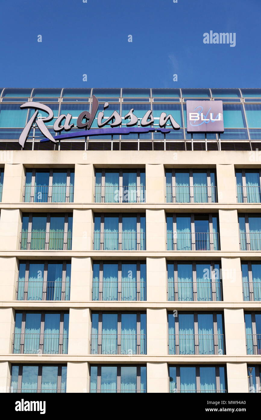 BERLIN, GERMANY - MAY 15 2018: Radisson Blu hotels and resorts logo on the building of hotel on May 15, 2018 in Berlin, Germany. - Stock Image