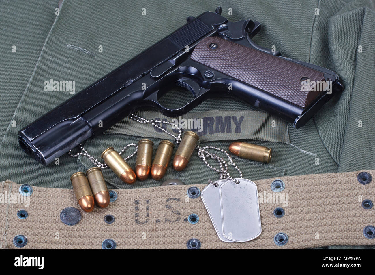 M1911 government with US ARMY uniform - Stock Image