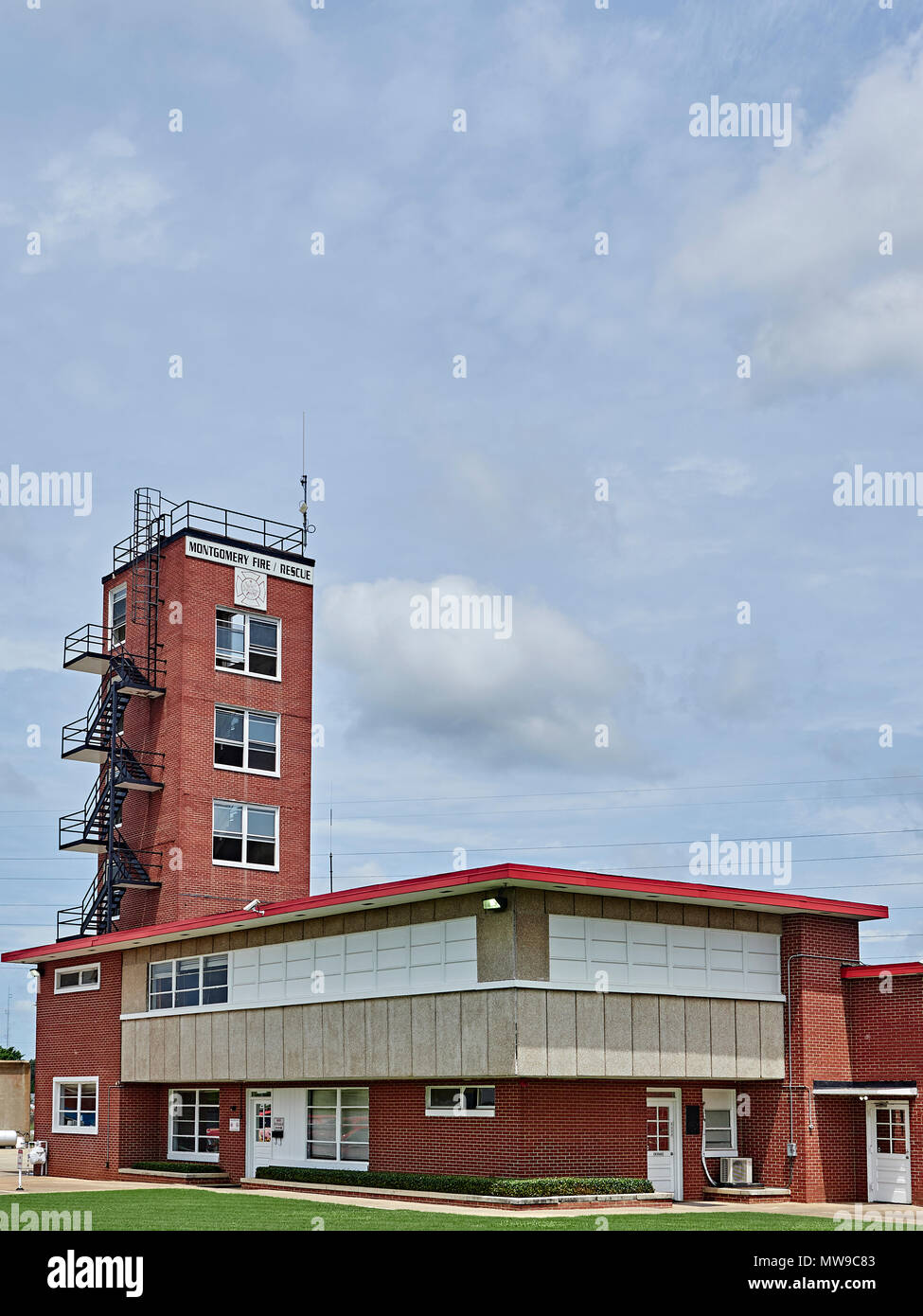 Exterior front of city fire station or fire house with a hose drying tower in Montgomery Alabama, USA. - Stock Image