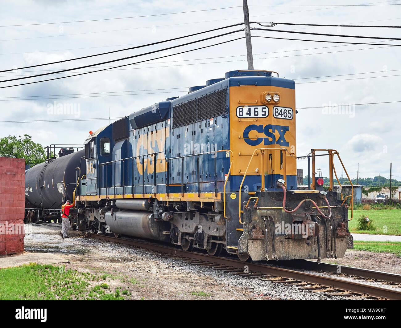 CSX Transportation locomotive, EMD SD40-2, #8465, in switching yard pushing freight cars, in Montgomery Alabama, USA. - Stock Image