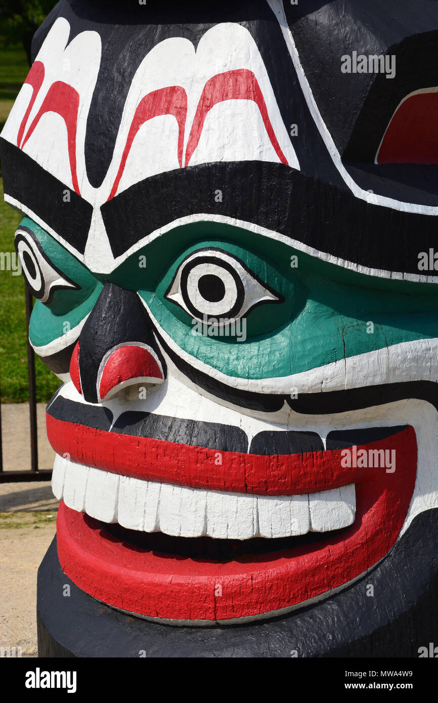 2018 Close up of the restored sea monster grimacing at the base of the Kwanusila totem pole located in Chicago's Lincoln Park near Addison Street. - Stock Image