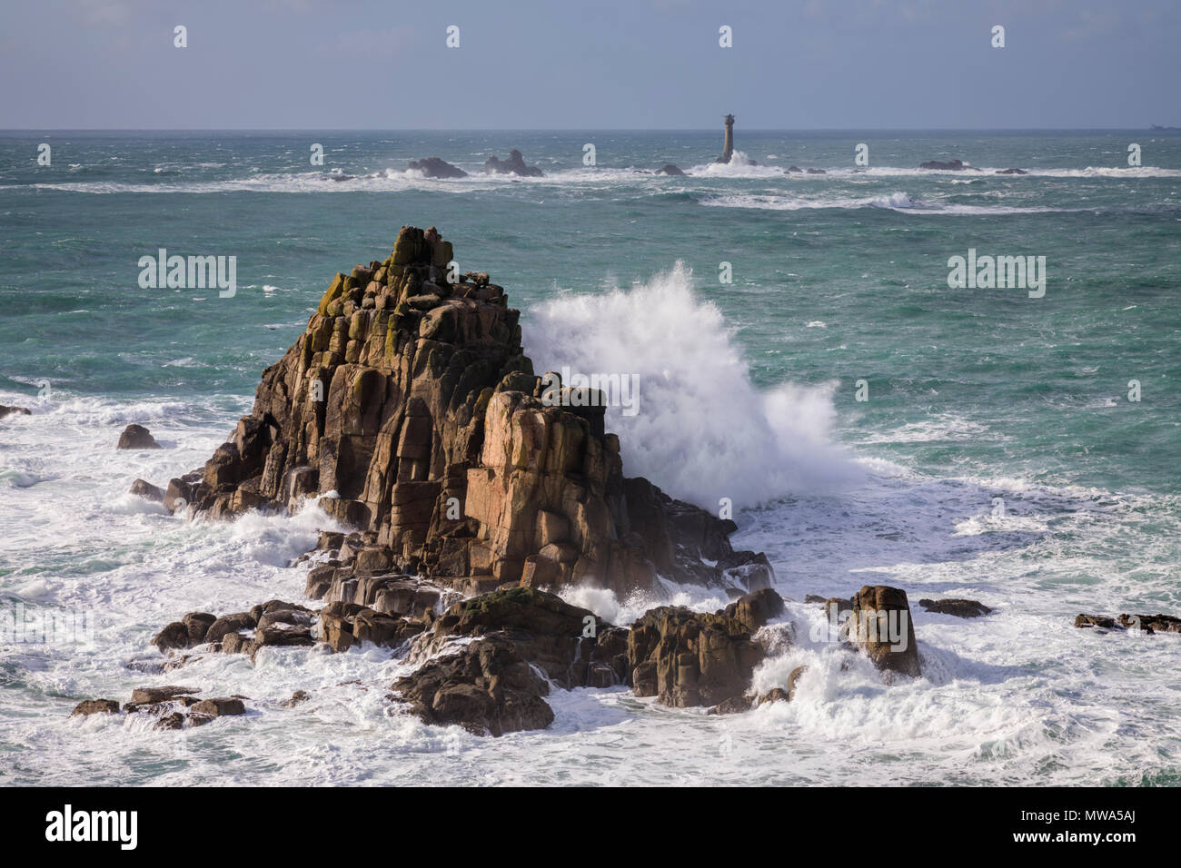 The Armed Knight and Longships Lighthouse at Land's End - Stock Image
