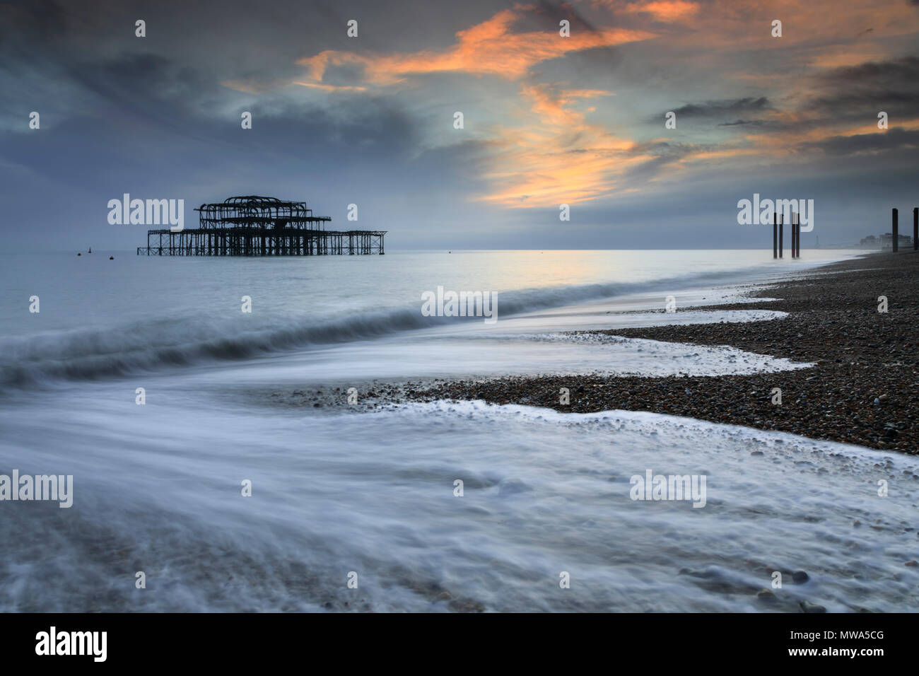 The remains of West Pier captured from Brighton Beach. - Stock Image