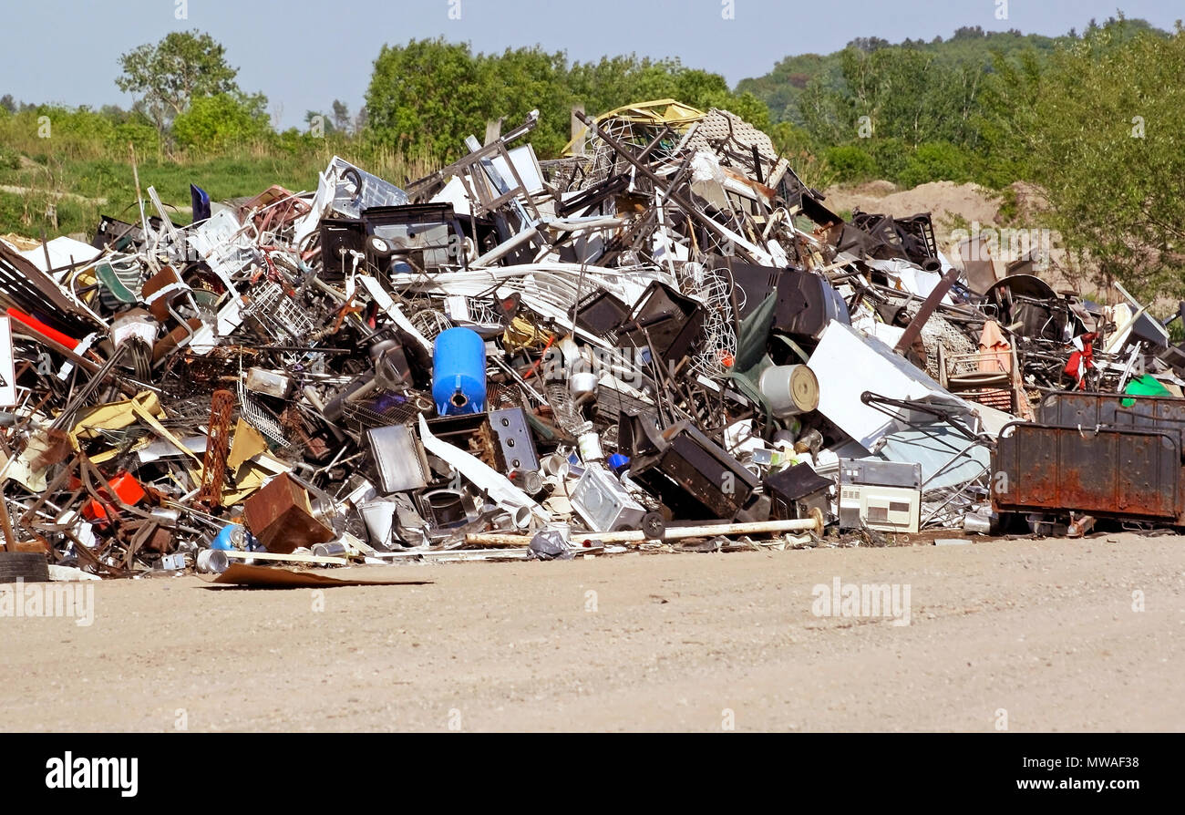 Pile of used and unwanted metal items at Landfill ready to be recycled - Stock Image