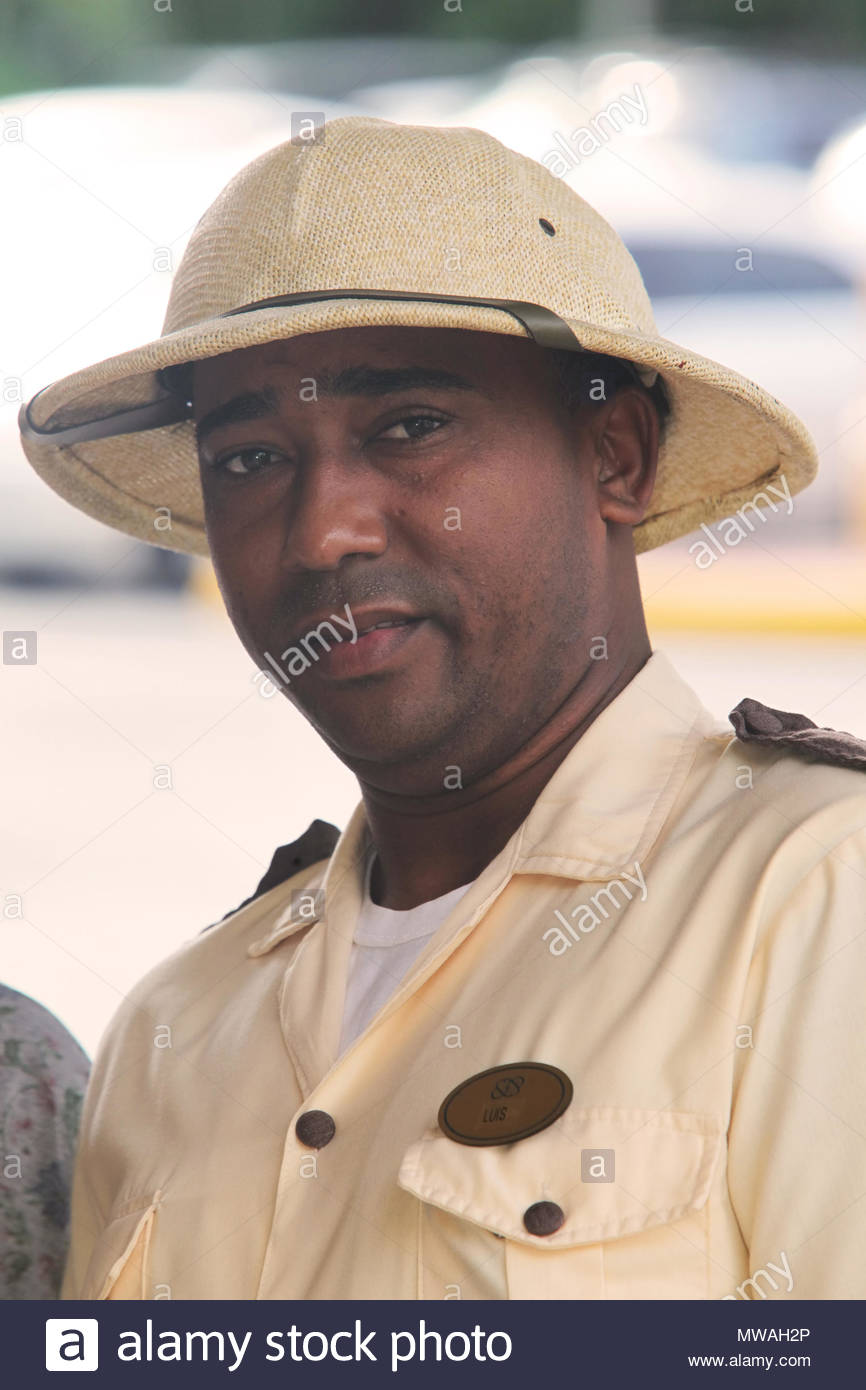 Bellboy wearing a British-style Safari uniform at the Occidental Grand Hotel in Punta Cana, Dominican Republic. - Stock Image