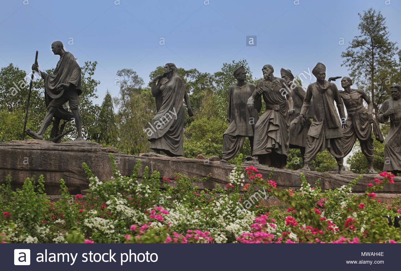 Statue of Mahatma Gandhi followed by figures from all walks of (Indian) society in New Delhi, Delhi, India. - Stock Image