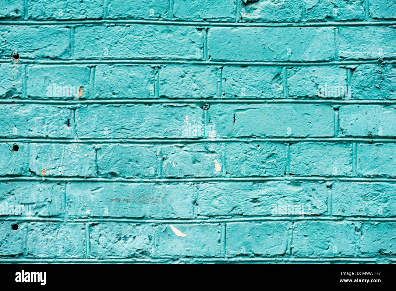 Painted turquoise vintage grunge brick wall texture urban background. Horizontal texture. For abstract background, pattern, wallpaper or banner design Stock Photo