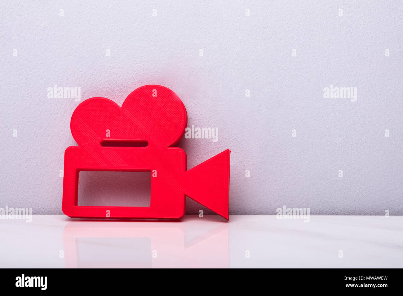 Red Video Camera Sign Against White Background - Stock Image