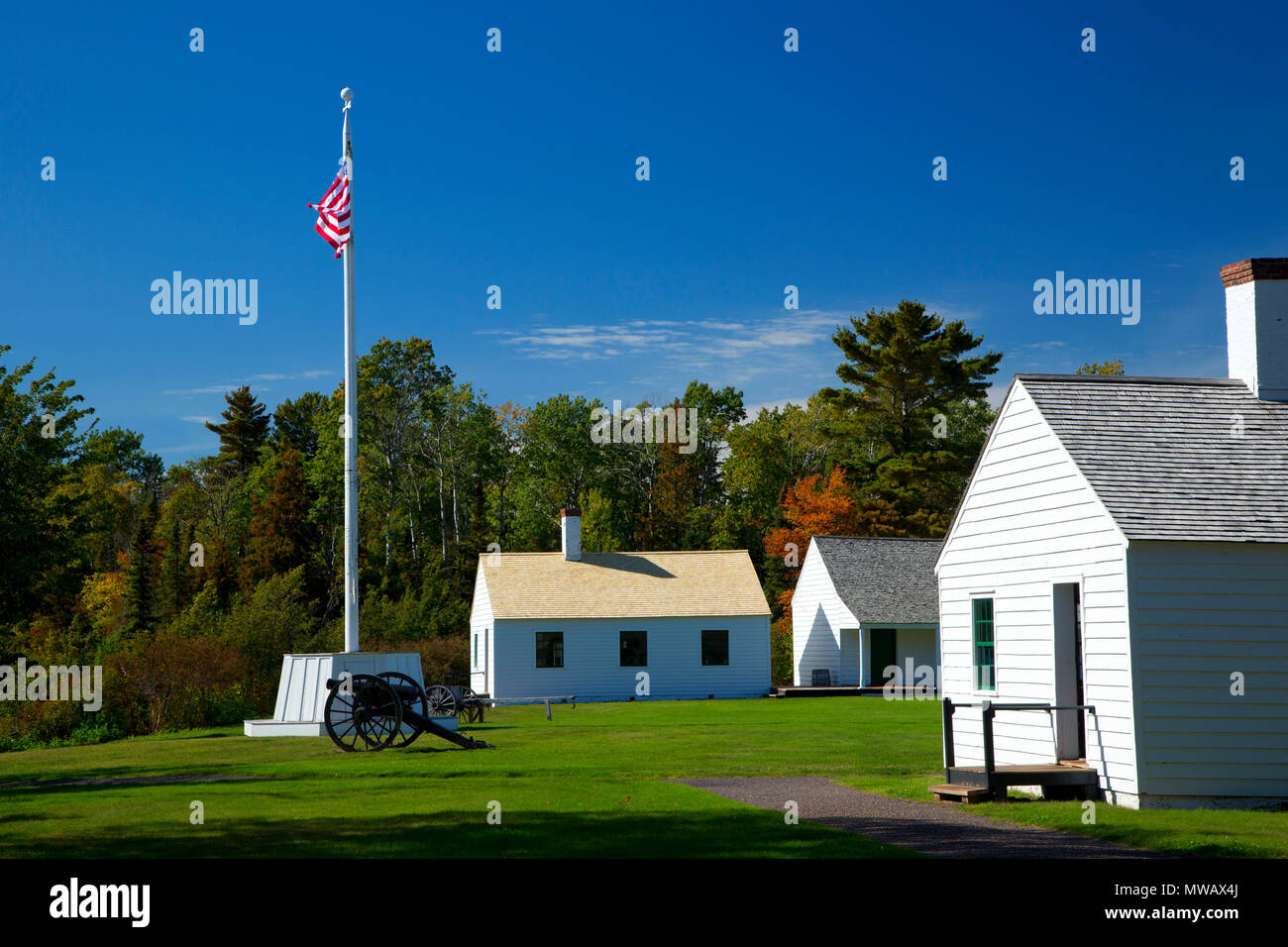 Flagpole and cannon by Kitchen and Mess Hall, Fort Wilkins Historic State Park, Michigan - Stock Image