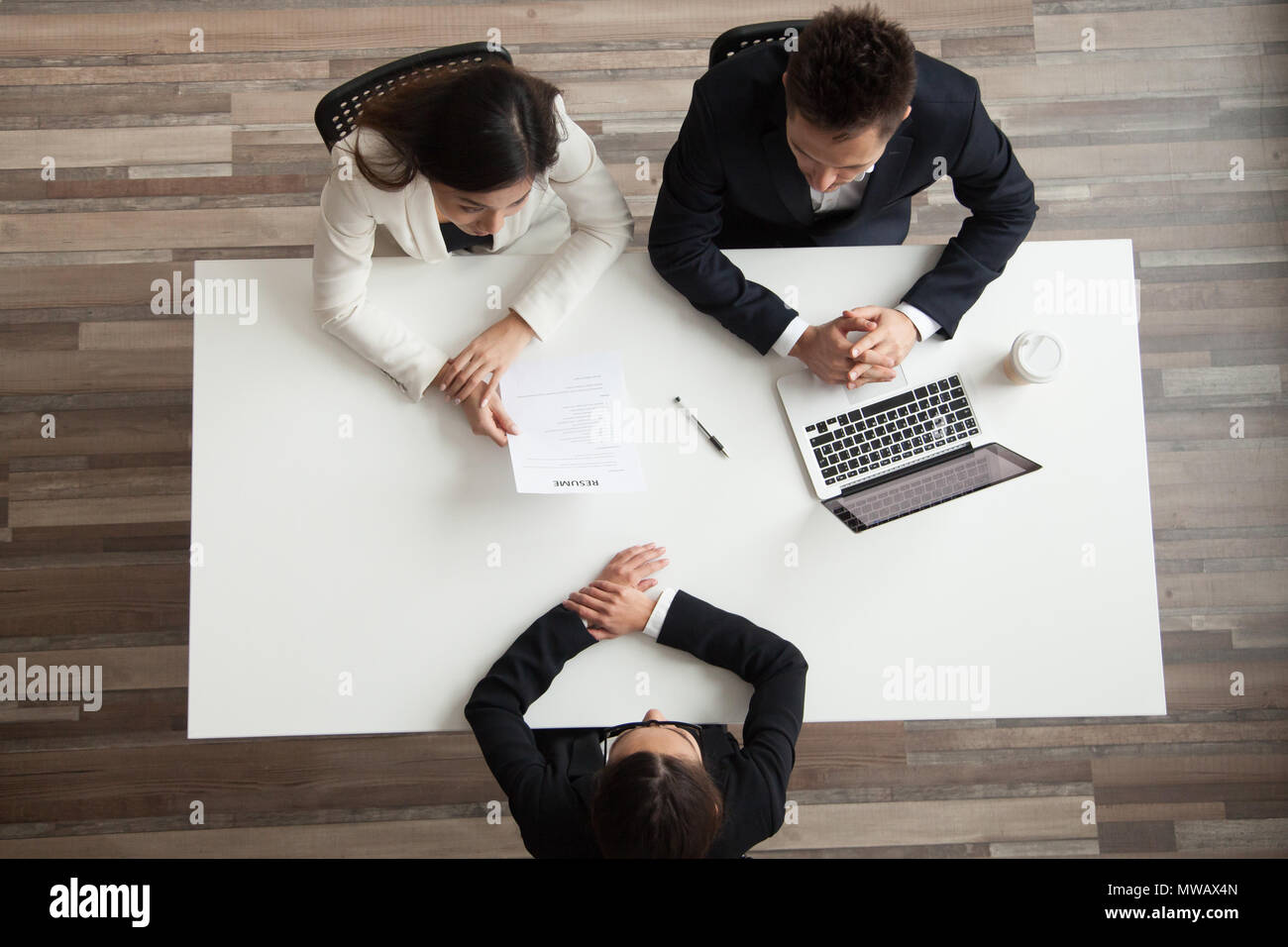 Hr managers interviewing female job applicant, top view from abo - Stock Image