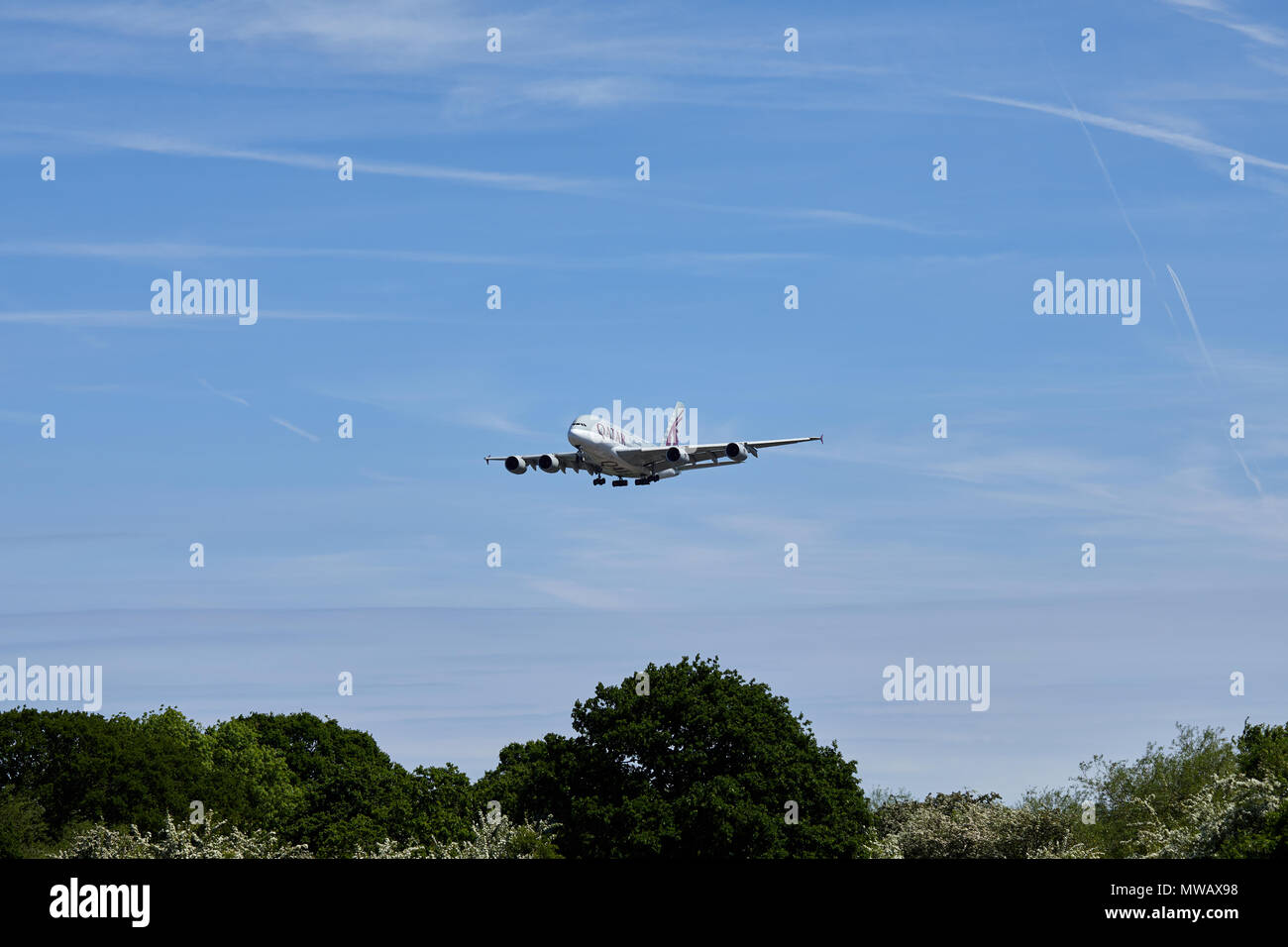 Qatar Airways Airbus A380-800 aircraft, registration number A7-APA, approaching a landing at London Heathrow airport. - Stock Image
