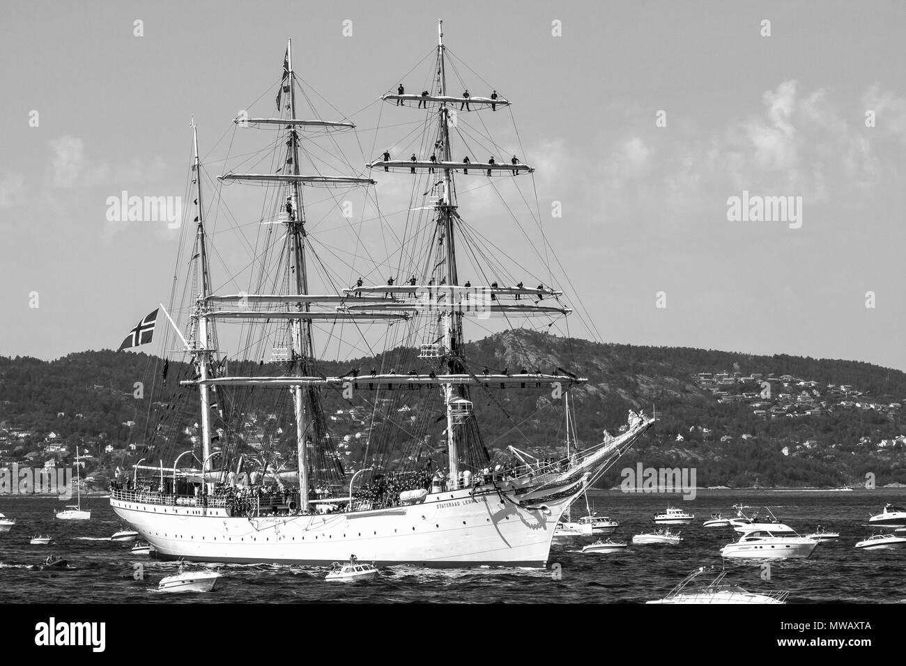 Tall Ships Race Bergen, Norway 2014.  Norwegian three-masted barque ''Statsraad Lehmkuhl'' arriving Byfjorden, Bergen with an armada of small boats. - Stock Image