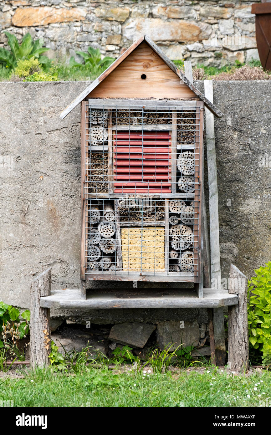 A homemade device at Gottweig Abbey in Austria designed to attract insect that would pollinate the Abbey's flowers. - Stock Image