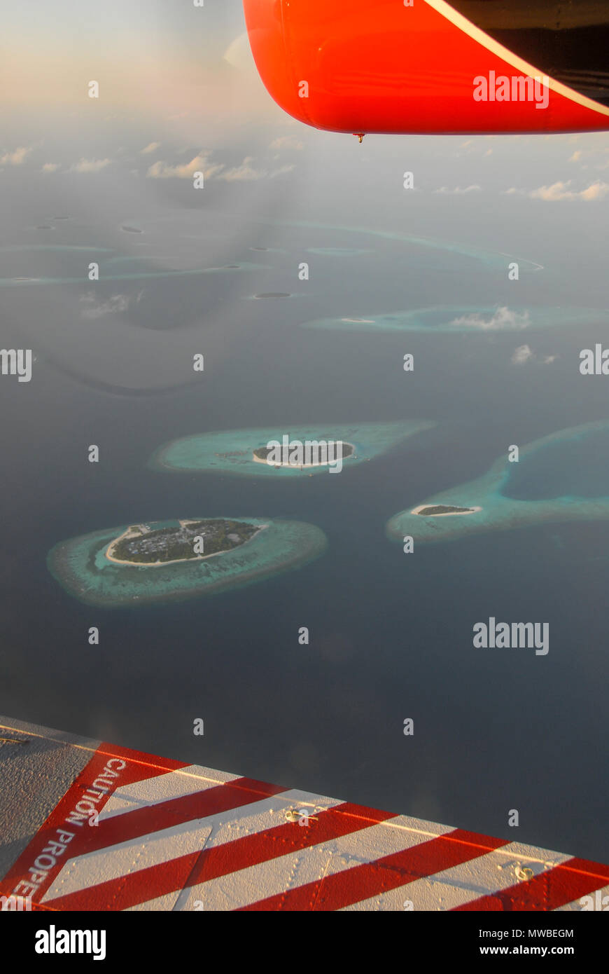 View of Maldives seaplaned of the Maldivian Air Taxi airline from Male, Aerial airborne view of islands and atolls within the Maldives, Indian Ocean.  - Stock Image