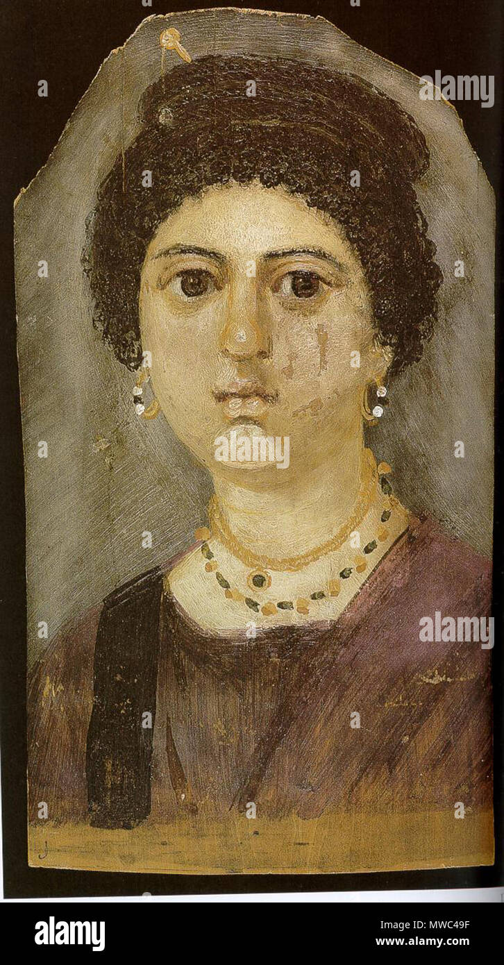 . Fayum mummy portrait. Portrait of a woman in encaustic on limewood: panel bearing an encaustic portrait of a woman wearing a gold hair-pin, earrings, emerald pendant and a purple mantle and tunic with a black clavus; cracks run from the broken upper edge . Scanned and edited by Eloquence. 203 Fayum-10 - Stock Image