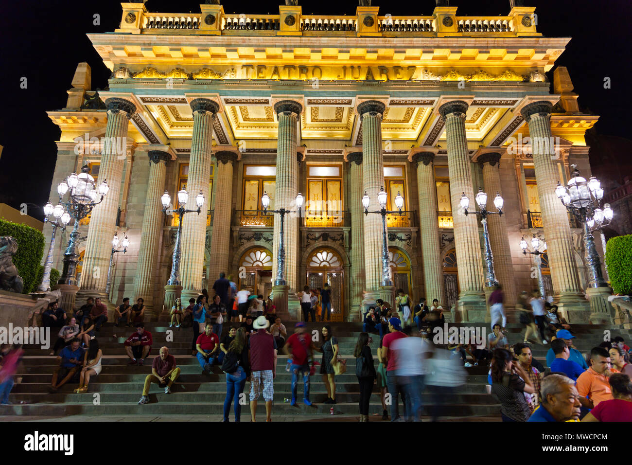 Tourist on the steps of the JUAREZ THEATER at night - GUANAJUATO, MEXICO Stock Photo