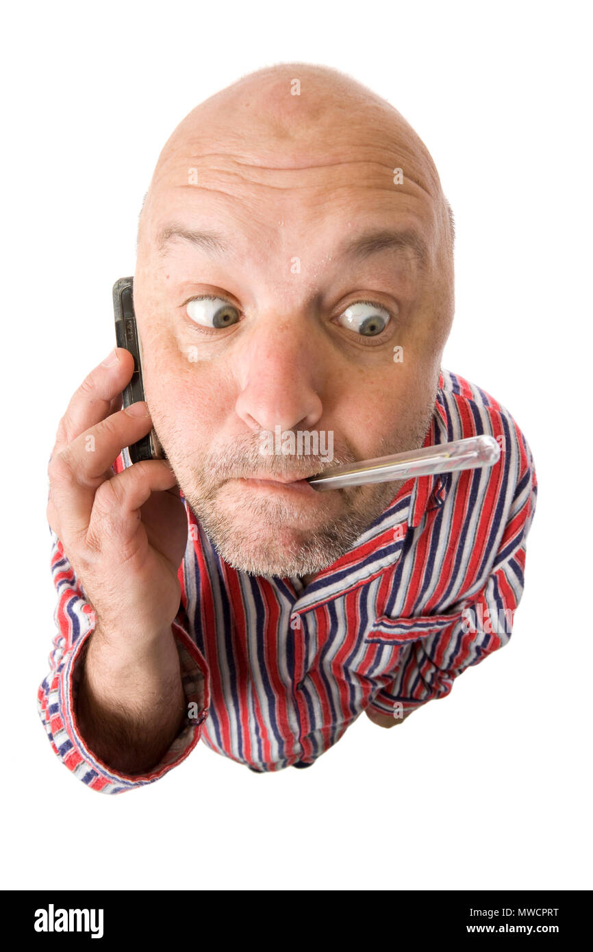 A guy with a flu checking his own temperature. - Stock Image