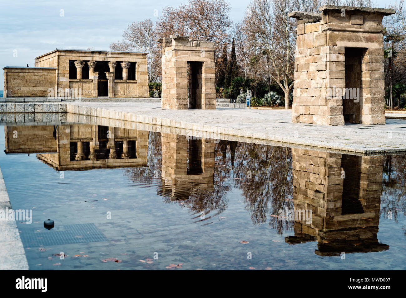 Egyptian Temple Of Debod in Madrid and water reflection Against Sky - Stock Image