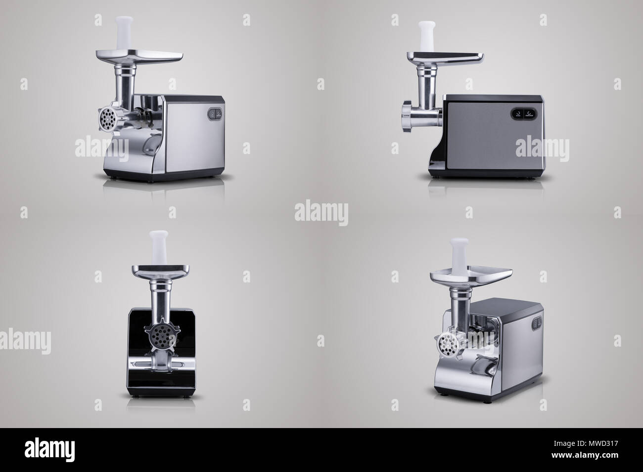 household electric meat grinder on a light gray background ...