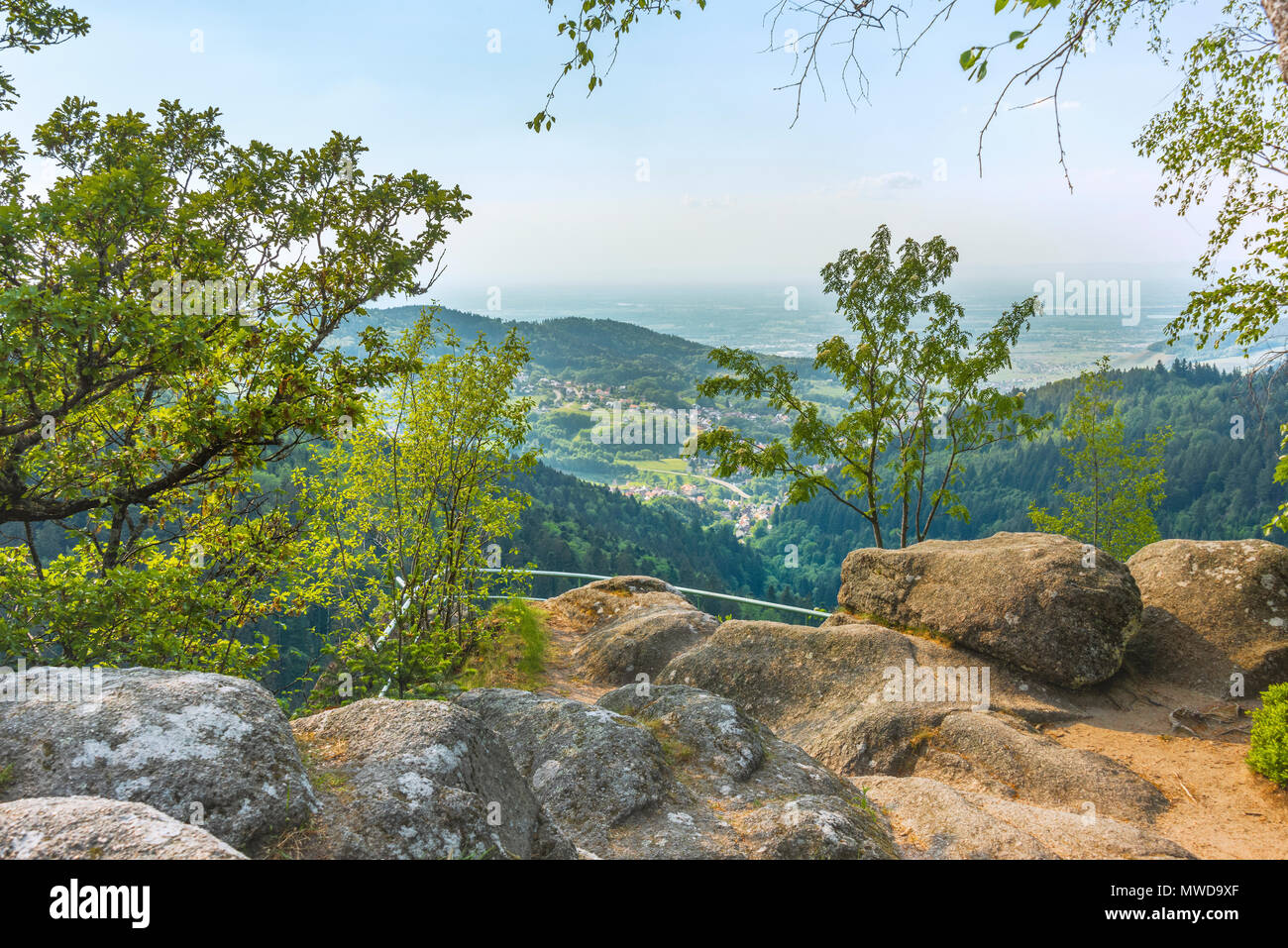 viewpoint Wiedenfelsen at the border of the Black Forest, Germany, view to the foothills with village Bühlertal and to the Upper Rhine Plain - Stock Image