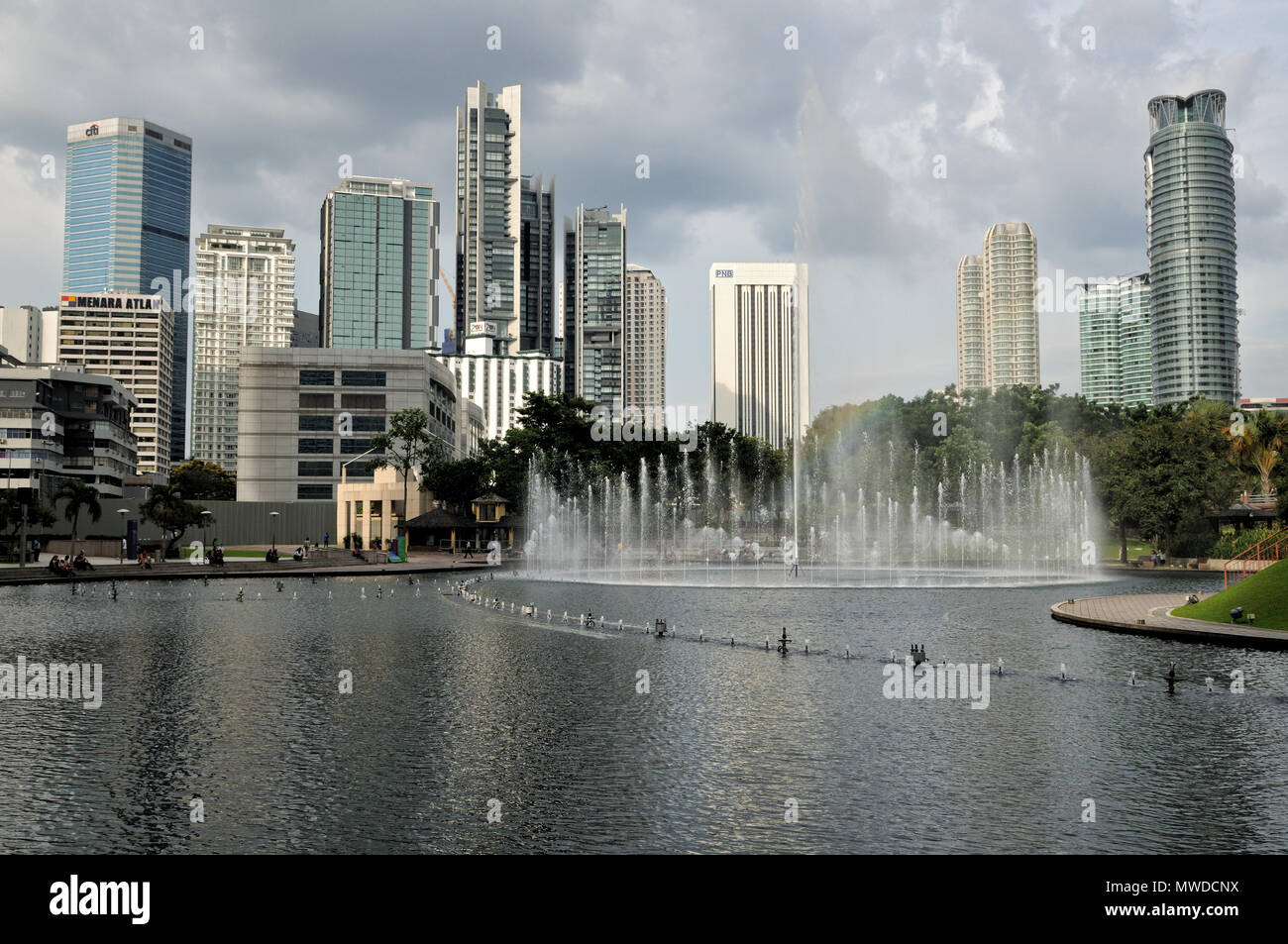 Fountains and surrounding buildings from KLCC park, Kuala Lumpur, Malaysia Stock Photo