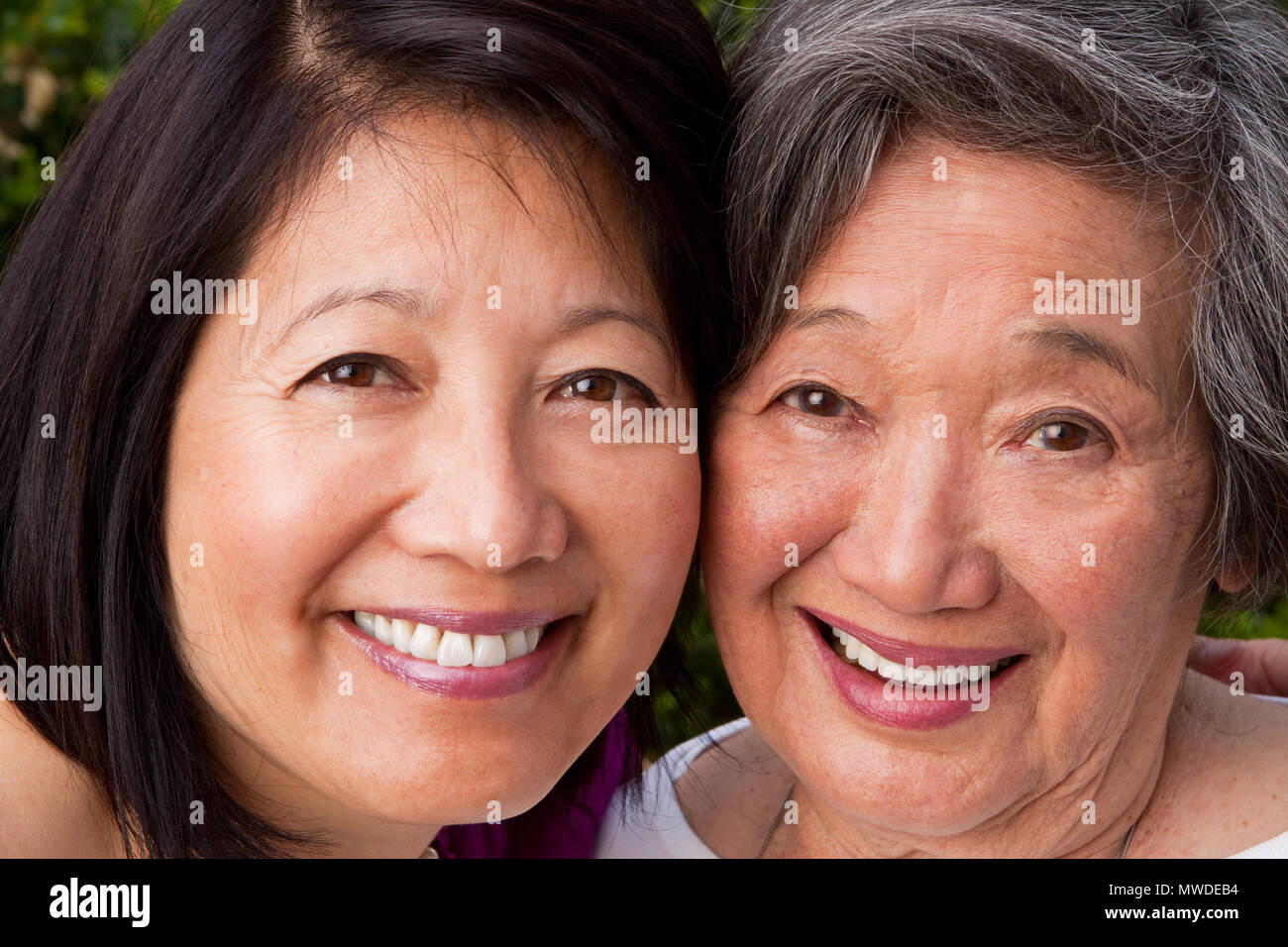 Mature Asian mother and her adult daughter. - Stock Image
