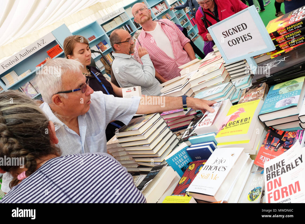 Hay Festival, Hay on Wye, UK - Friday 1st June 2018 - Visitors to the Hay Festival bookshop browse a selection of signed copies of books by auhors appearing at the Festival - Photo Steven May / Alamy Live News - Stock Image