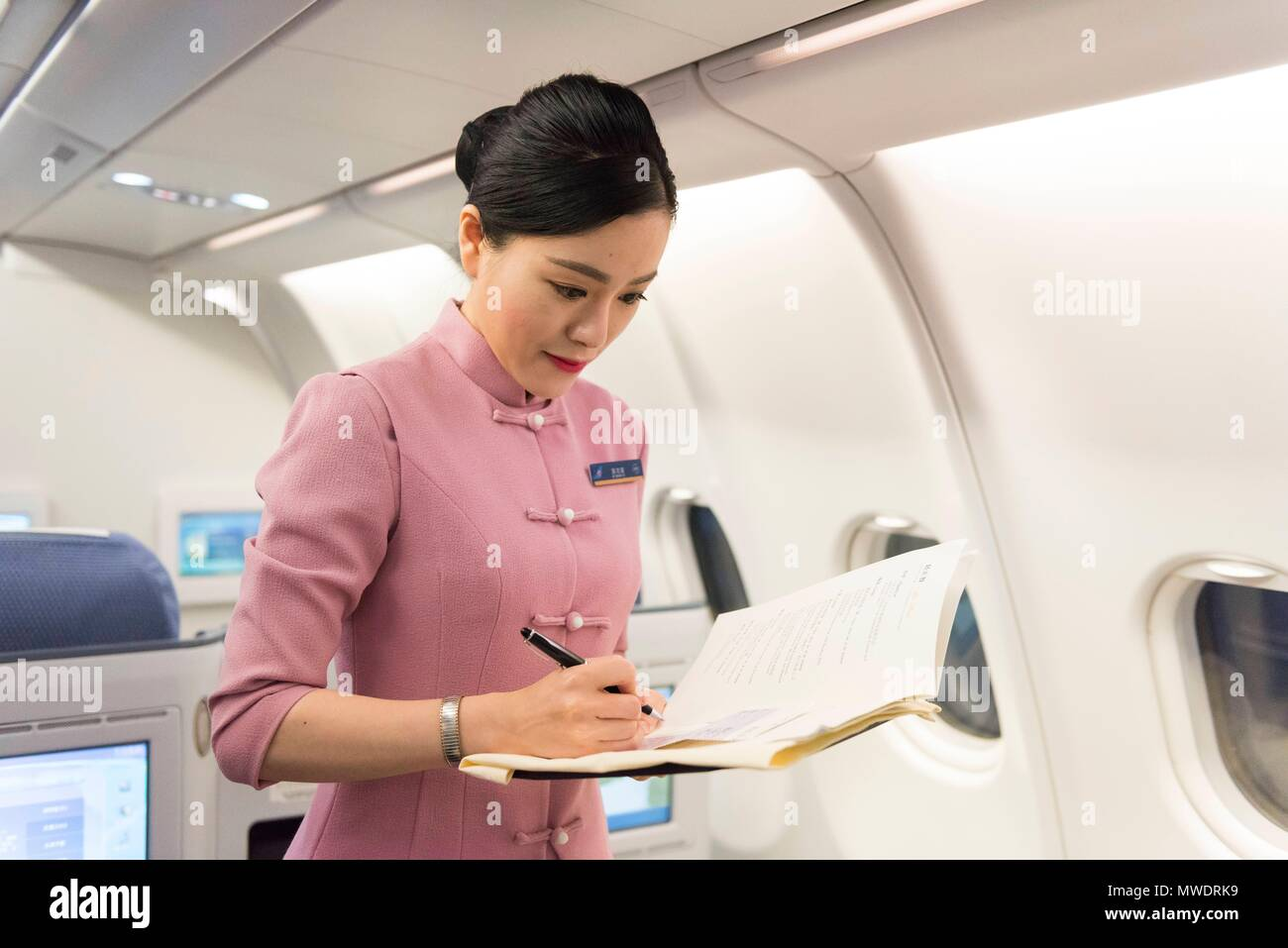 Cabin crew at the New China Southern Airlines flight from London to Wuhan that took off from Heathrow Airport on 30 May at 22:10pm and arrived to Wuhan Airport on 31 May at 15:35pm. Wuhan, China. 31/05/2018 | usage worldwide - Stock Image