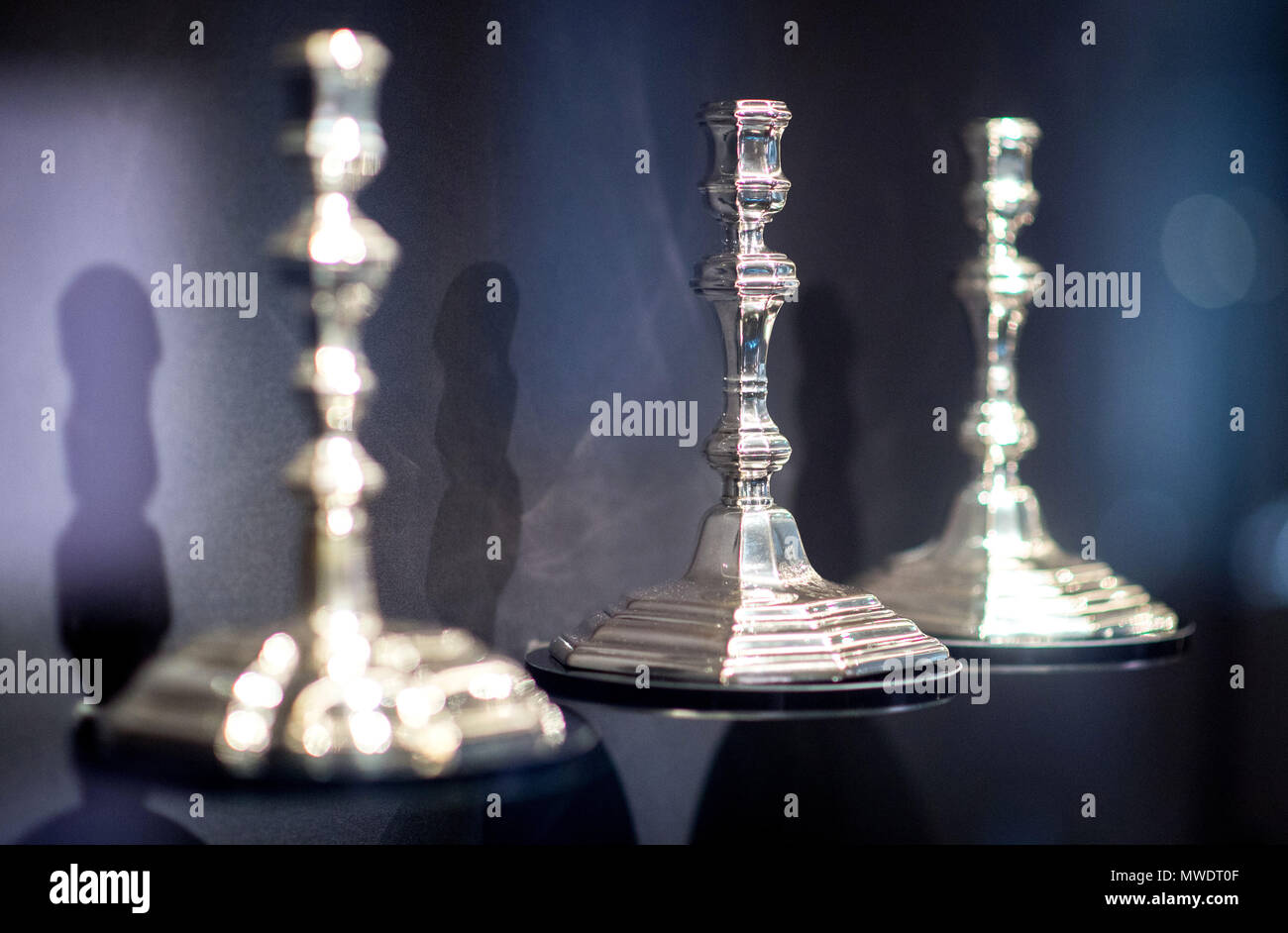 31 May 2018, Germany, Celle: Candle holders made of silver are on display at the Residenzmuseum. After a month-long redecoration, the gold and silverware collection that was formerly used by royalty and the upper classes is on display again. Photo: Hauke-Christian Dittrich/dpa - Stock Image